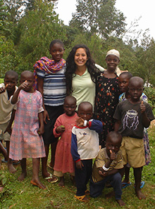 Dr. Isis Mejias Carpio with children in Kenya during a global grant project.