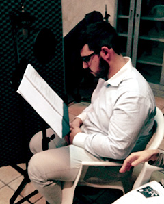 A member of the Rotaract Club of Caltanissetta, Sicily, records a section of an audio book.