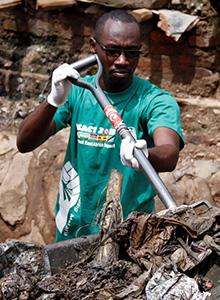 A Rotaract member clears a drainage ditch.