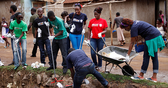 Members of Rotaract clear blocked ditches and conduct other improvements in the Nyalenda settlement of Kenya.