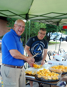 Members of a Rotary Club in Illinois, USA, cut oranges during an event to raise money for club projects.