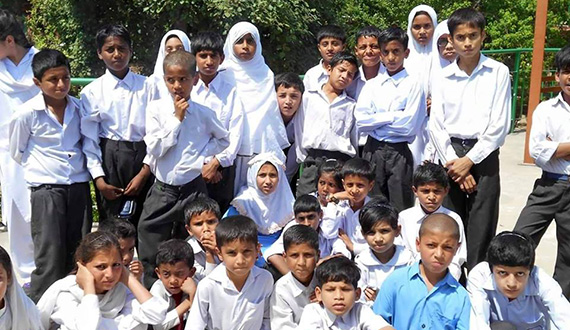 Children gather in the park for a Rotary-sponsored picnic in Islamabad, Pakistan.