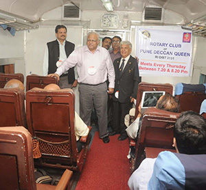 Members of the Rotary Club of Pune Deccan Queen meet on the passenger train between Pune and Mumbai.