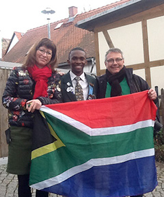 Thando Gwatyu shares the South African flag with his host family in Germany.