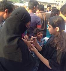 Children receive their toys in Badami Bagh, Lahore, Pakistan.