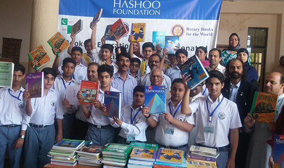 Students at St. Mary's Academy in Rawalpindi, Punjab, Pakistan, display the books they received from the Rotary Books for the World program and the Hashoo Foundation.