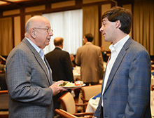 Bobby Keith, a member of the Rotary Club of Birmingham, Alabama, chats with David Knight, a member of the Rotaract Club of Birmingham, during a recent meeting.