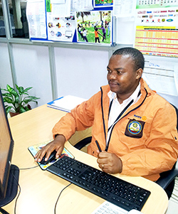 Hannington Sebuliba works on an issue of his club's bulletin.