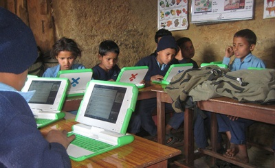 Students in Nepal use laptops provided by OLE Nepal. Photo by OLE Nepal