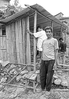 Rotary members in Nepal build shelters for earthquake survivors.