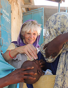 Ann Lee Hussey administers polio drops to a child in Chad in 2013.