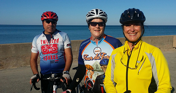 Kristin Brown, center, her husband, Mahmoud Ajamia -- who will also be riding in Tucson -- and Marga Hewko at the bottom of a steep hill on a recent training ride.