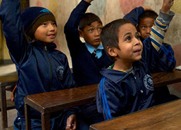 Students eagerly participate in a classroom where the teacher has received training.