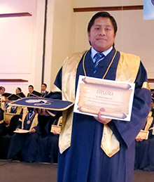 Jose with his high school diploma.