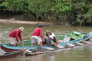 Rotary members establish a river crossing with the help of anchors.