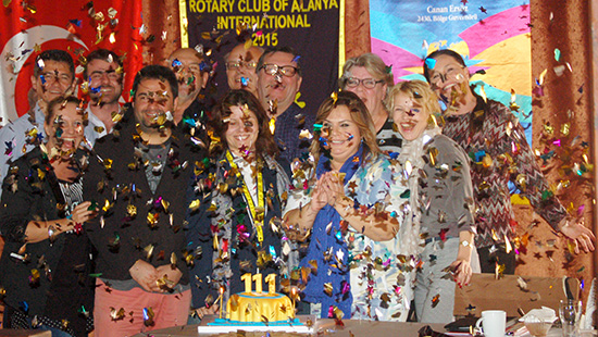 The Rotary Club of Alanya International, Turkey, with confetti and cake.