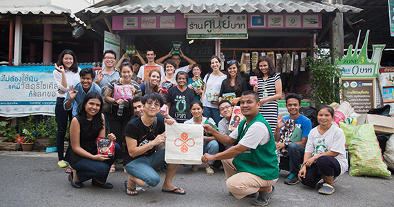 The three Rotary alumni and DSLI Global participants at the Zero Baht Shop Community, a domestic migrant community that has developed a recycling program that funds community insurance and social support programs.