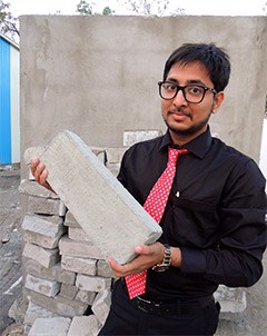Desai and his brick