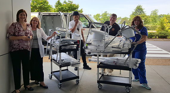 Rotary members in Virginia, USA, deliver mobility equipment for a local hospital.