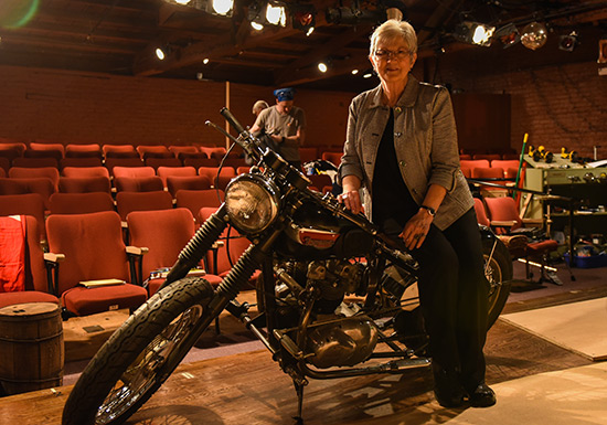 : Nancy Wright Beasley, who wrote The Little Lion, sits on one of the motorcycles used in the stage adaptation of her book during rehearsal at Swift Creek Mill Theatre. Photo by Clement Britt