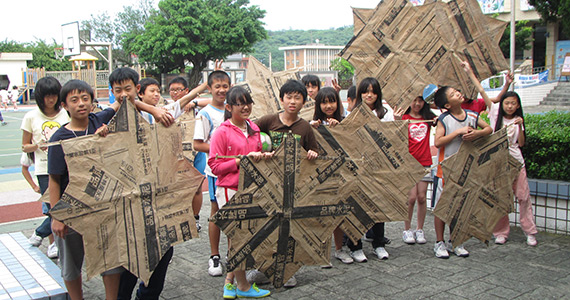 Students show off their construction skills by making kites out of newspapers during classes supported by the Rotary Science Education Program.