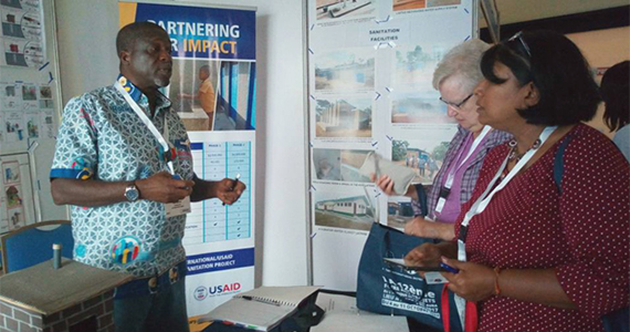 Ako Odotei greets Rotarians from the U.S. during the West African Project Fair in Accra.