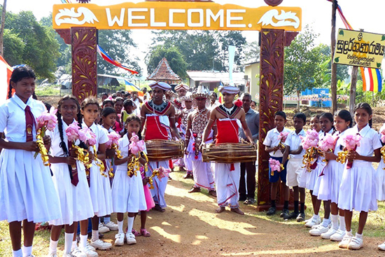 Villagers in Vanni Pallugollewa, Sri Lanka, welcome the visiting Rotary members.