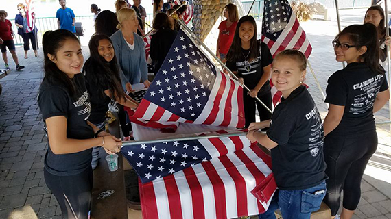 ae5c869e82f High school students work on posting flags for the event.
