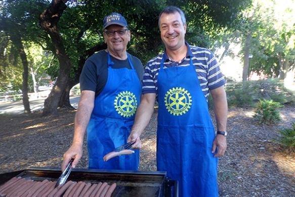 John Smerdon and Daniel Vankov prepare sausages for the homeless.