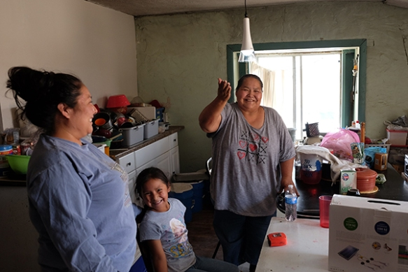 A Navajo family enjoys their newly installed solar light.