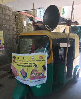 A vehicle announces the immunization drive.